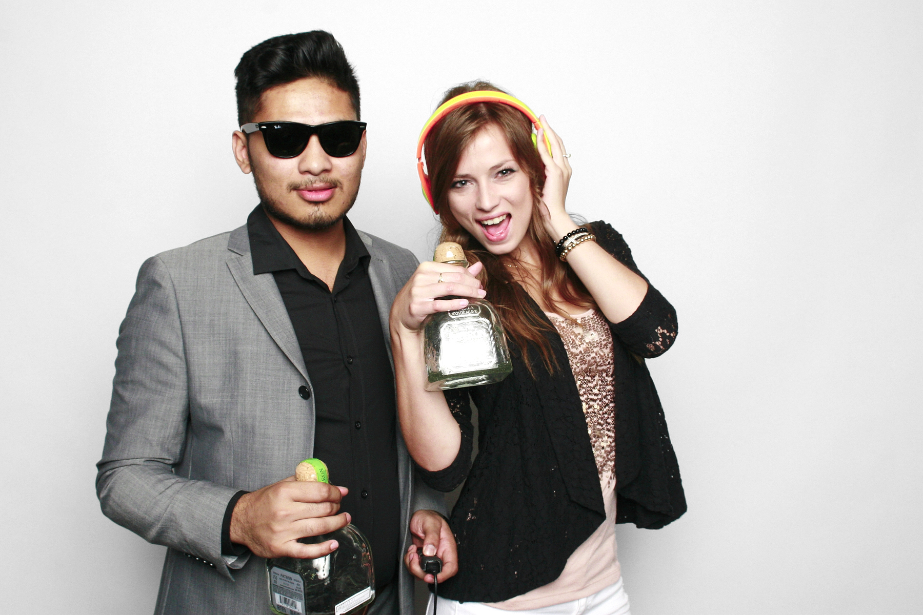 MTV VMA Viewing Party NYC couple posing with Patron bottles in The Booth