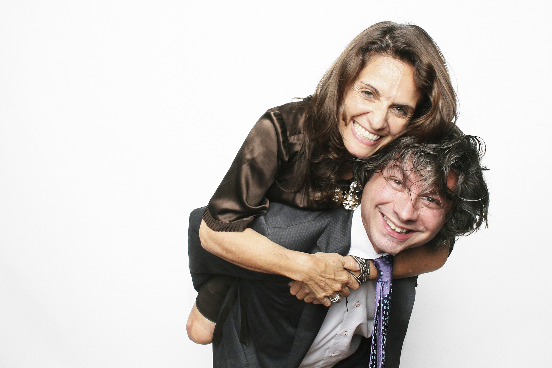 Mitzvah Parents Piggyback in photo booth