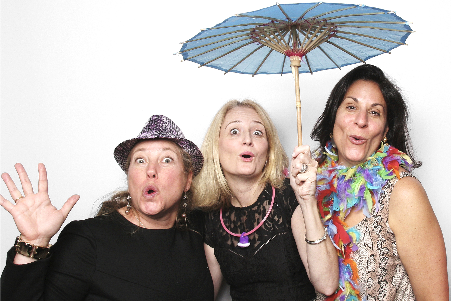 Mitzvah Parents with umbrella photo booth