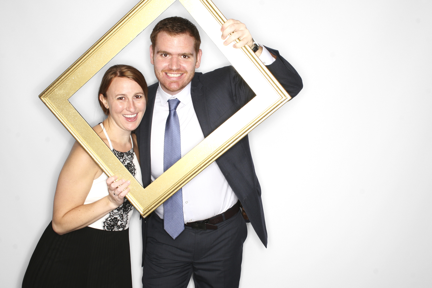 Couple smiling with frame in New York Photo Booth