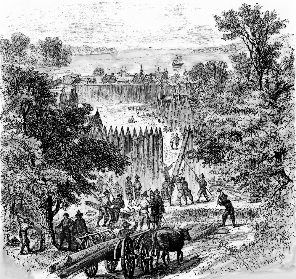 Dutch settlers building a stockade wall, similar to the one once found protecting Kingston, NY. North Wind Picture Archives / Alamy Stock Photo