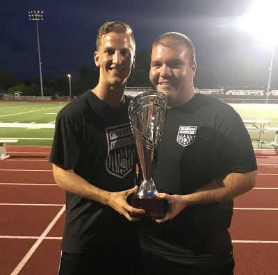 Nick Hoffay (right) holding the Stockade FC's 2017 Conference Championship trophy