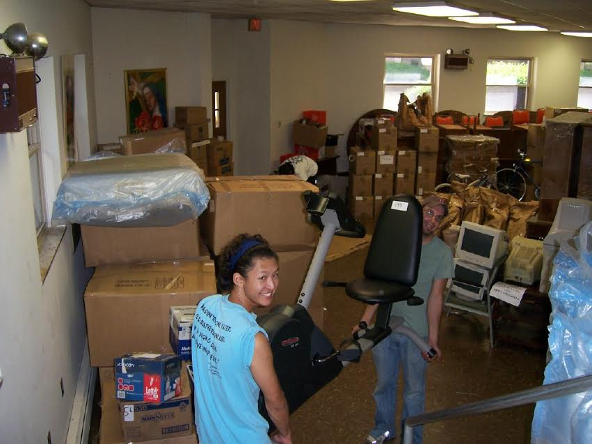 First - Volunteers load 50 wheelchairs, bicycles, computers and medical supplies into a 40 ft. shipping container bound for Peru..jpg