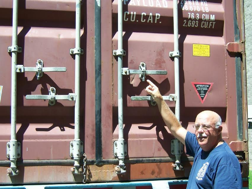 Fourth - anthony Dellomo locking the 40 ft. shipping container filled with supplies..jpg