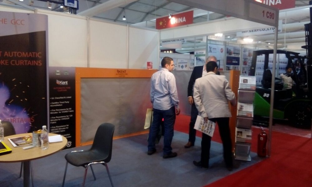 Our team at Big 5 Saudi Arabia with visitors explaining about Draft Curtains