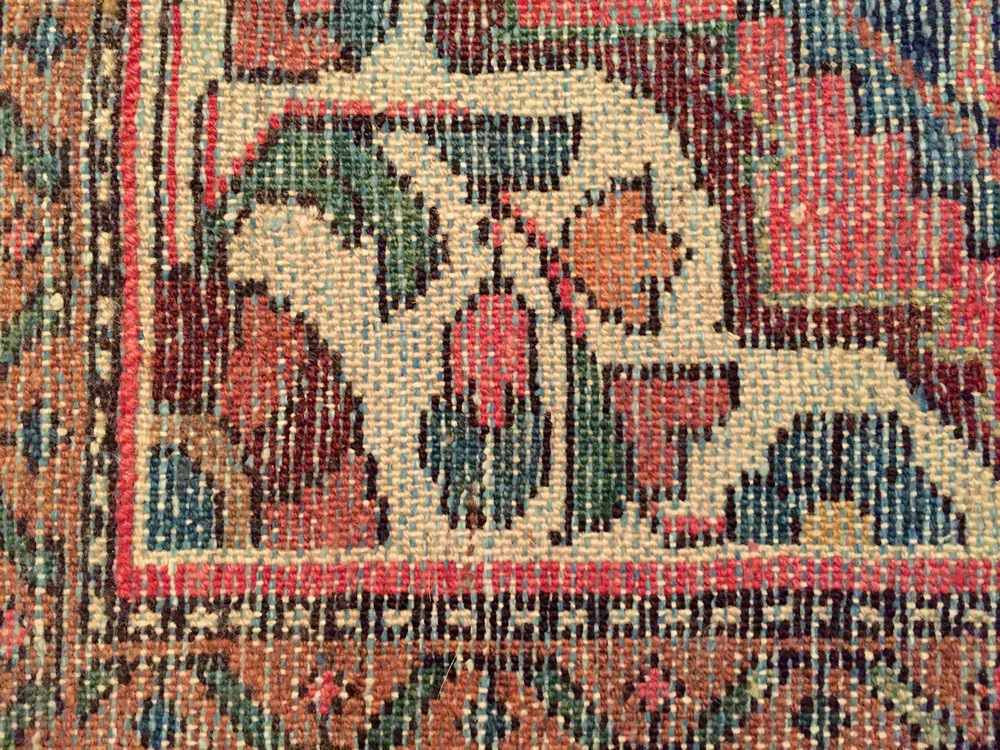 Back side of hand-knotted rug.