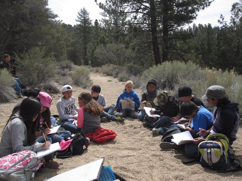 kids writing on trail.jpg