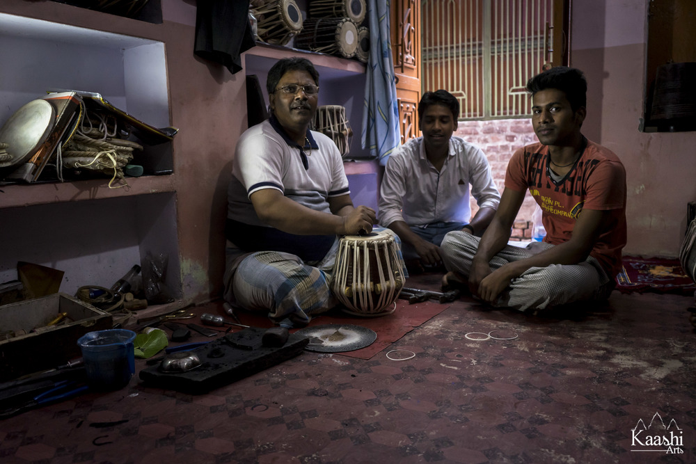 Sri Anwar Mohammed Saheb, a 3rd generation Tabla maker. Sitting with his sons, the 4th generation of artisans - Benares, India.