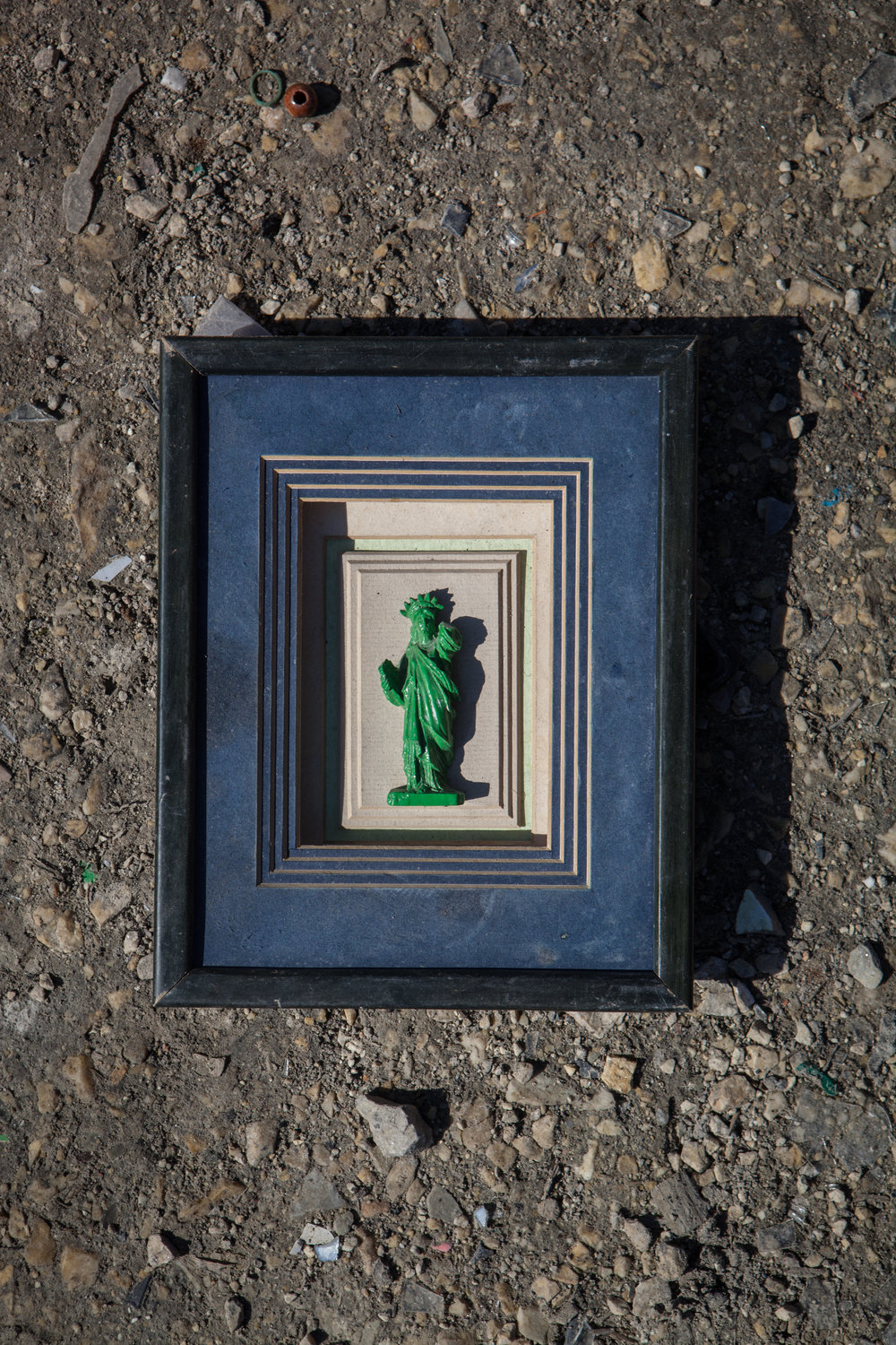 The last found object is my favourite.  This green plastic framed statue of liberty was missing it's torch to shine the light of justice and was lying abandoned amongst the rubbish.