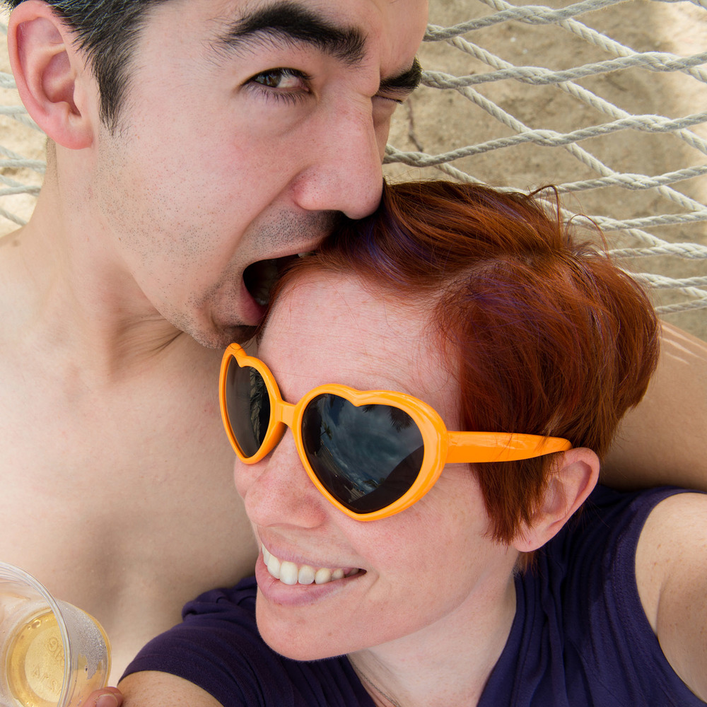 My favorite hair is purple and red and pixie cut, but I just don't have it in me to keep that up, so you'll generally see me in some stage of growing it out.  And those sunglasses - they are a reminder to seek out the good and put love into the world!  And that guy biting my head - he's my husband.  I love that guy.