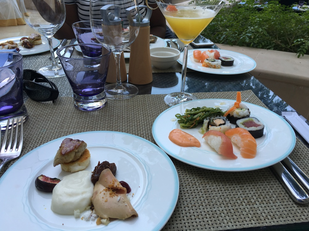 Left: foie gras platter. Right: sushi and sashimi selection, with seaweed salad and spicy mayo.