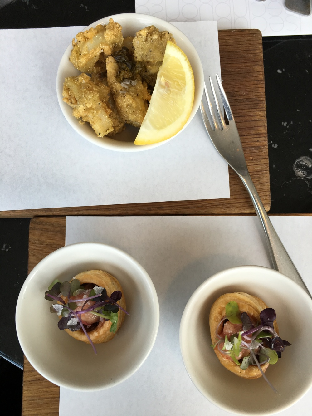 Top: Crispy squid with capers and lemon. Bottom: Bone marrow poppers!