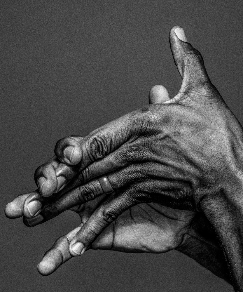 The hands of Robert Shaka photographed by Benedict Evans for Wired UK.
