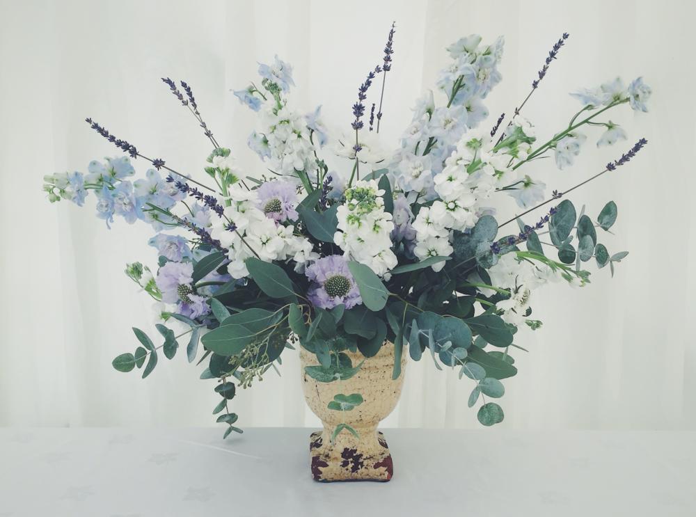 london kent wedding florist urn arrangement with purple scabious, blue delphinium, lavender and white stock flowers
