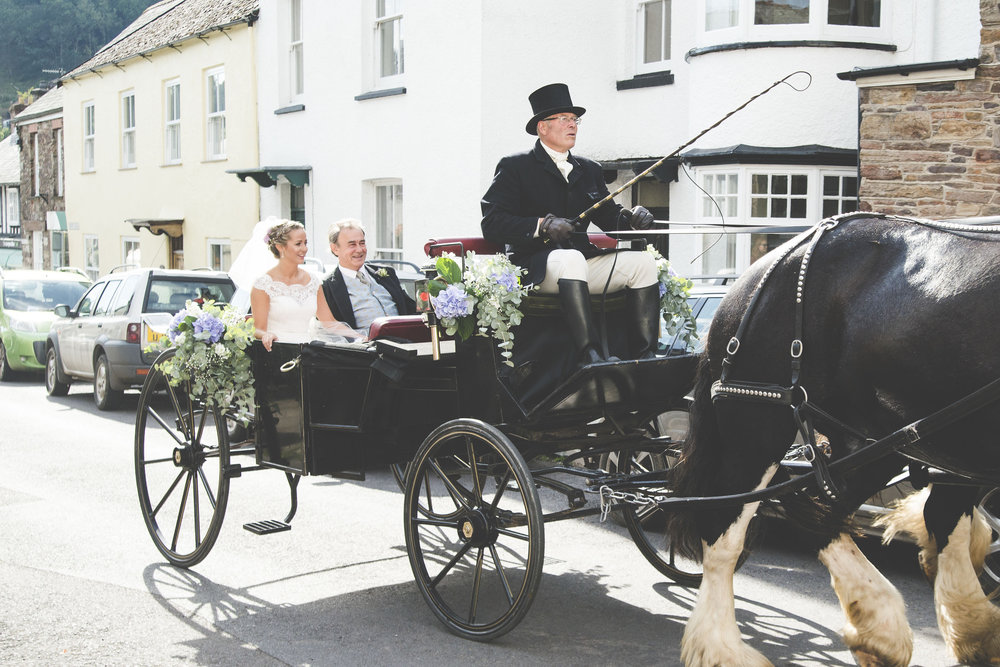 Flowers by Jennifer Pinder. Horse and cart floral wedding decoration with blue hydrangea, white roses and gypsophila