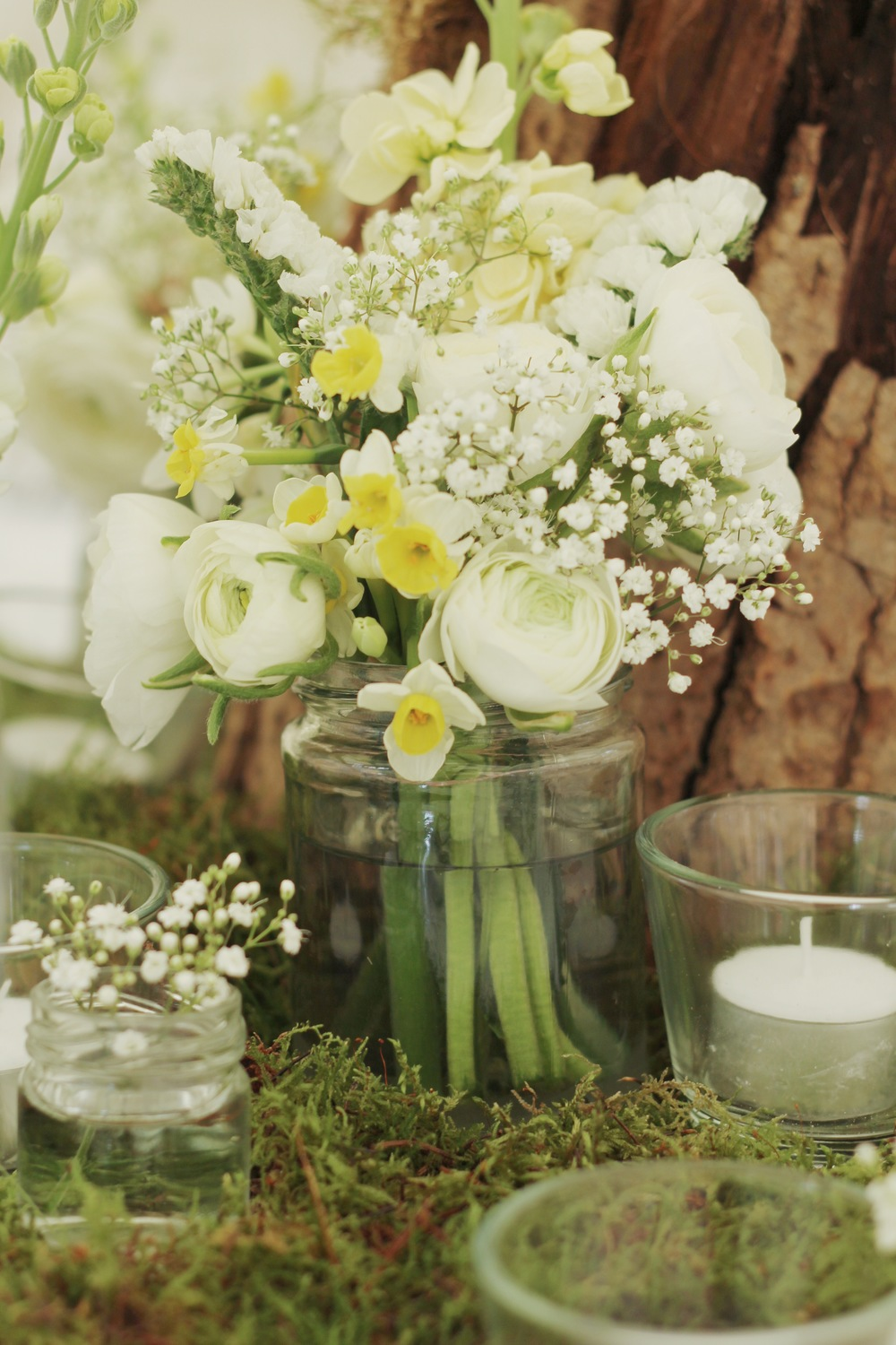 flowers by Jennifer Pinder pale white and yellow jam jars flowers with moss.JPG