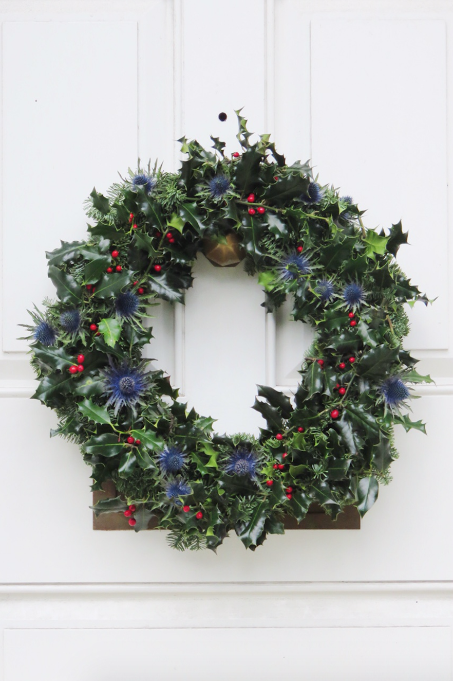 Christmas wreath by Jennifer Pinder for a traditional winter wedding at the Old Library in Dulwich College in London