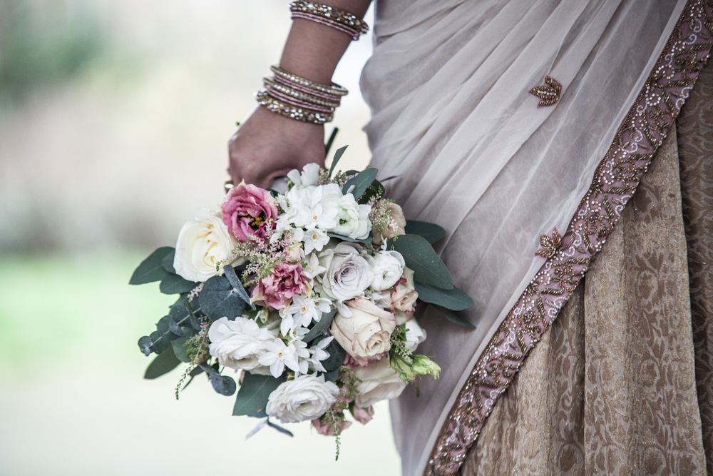 kent london wedding florist penshurst peach pink and dusky purple flower bouquet with indian sari.jpg