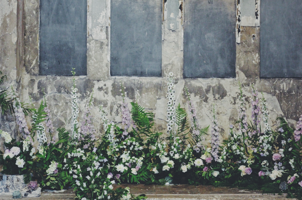 Flowers by Kent florist Jennifer Pinder a wedding hedgerow arrangement at the Asylum in Peckham London