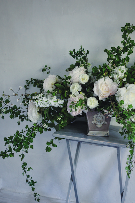 Flowers by Jennifer Pinder. A Wedding florist based in Kent and London. The arrangement uses ranunculus and peonies.