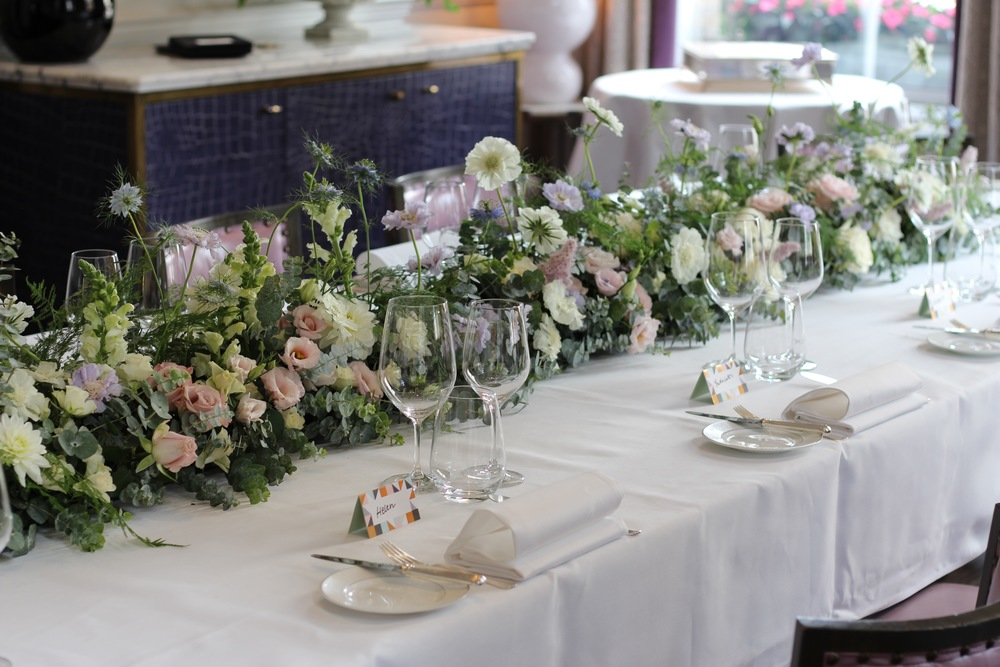 pastel floral table garland by Kent florist Jennifer Pinder at the Langham Hotel in London for a summer wedding
