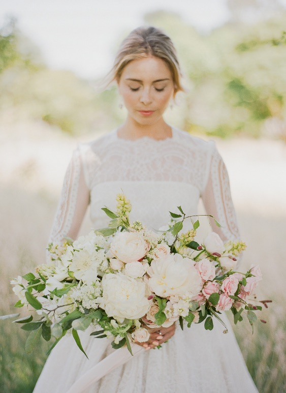 Kent florist Jennifer Pinder for a botanical inspired wedding at Falconhurst wedding venue in Kent with pale pink and white tones photos by Julie Michaelson