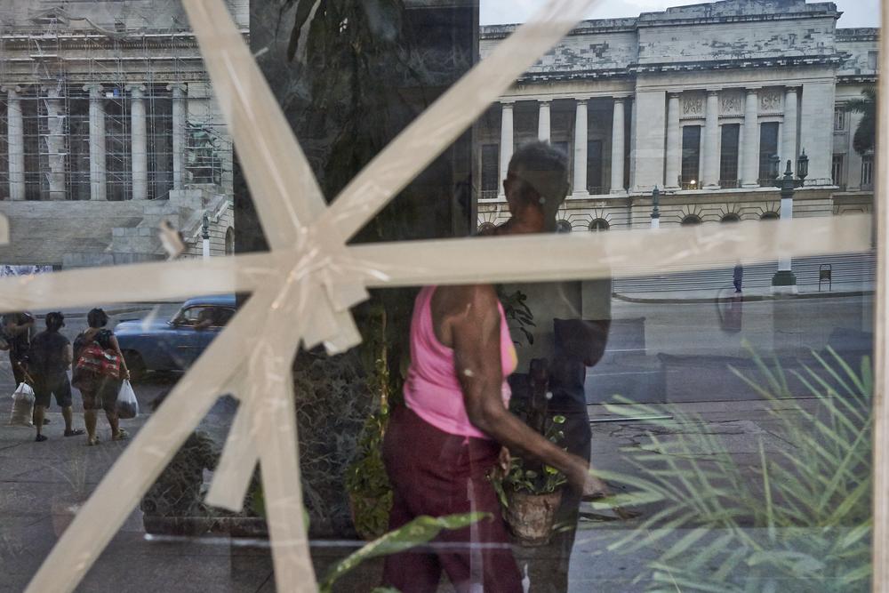 08 Cleaning woman broken window.jpg
