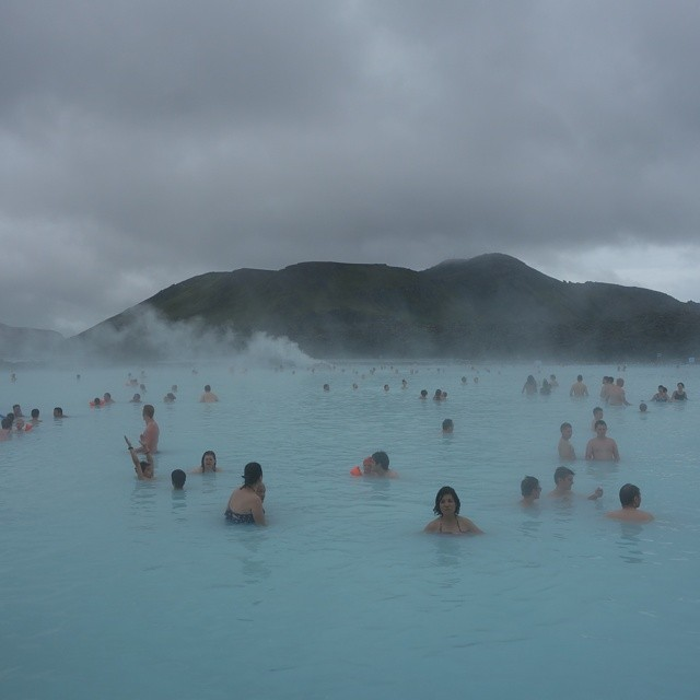 An international group of people choosing to relax in a volcano-powered outdoor spa. #Iceland #latergram #bluelagoon