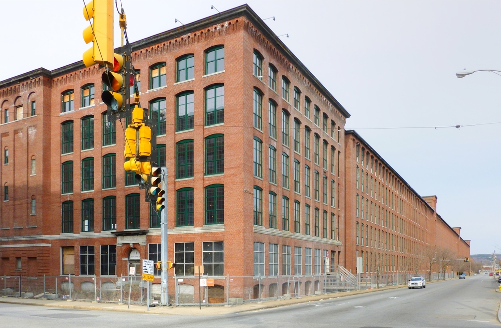 Massachusetts' mill buildings, a legacy of our industrial past, are well-suited for 21st century needs.  Recently renovated Wood Worsted Mills, Lawrence MA   [photo by EMW, 3/23/14]