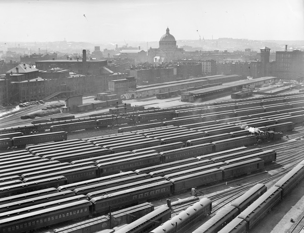 View of the sprawling Boston & Albany yards from the Lenox Hotel, on the corner of Boylston and Exeter Streets, looking toward the Christian Science Church, ca. 1930 [Boston Public Library]