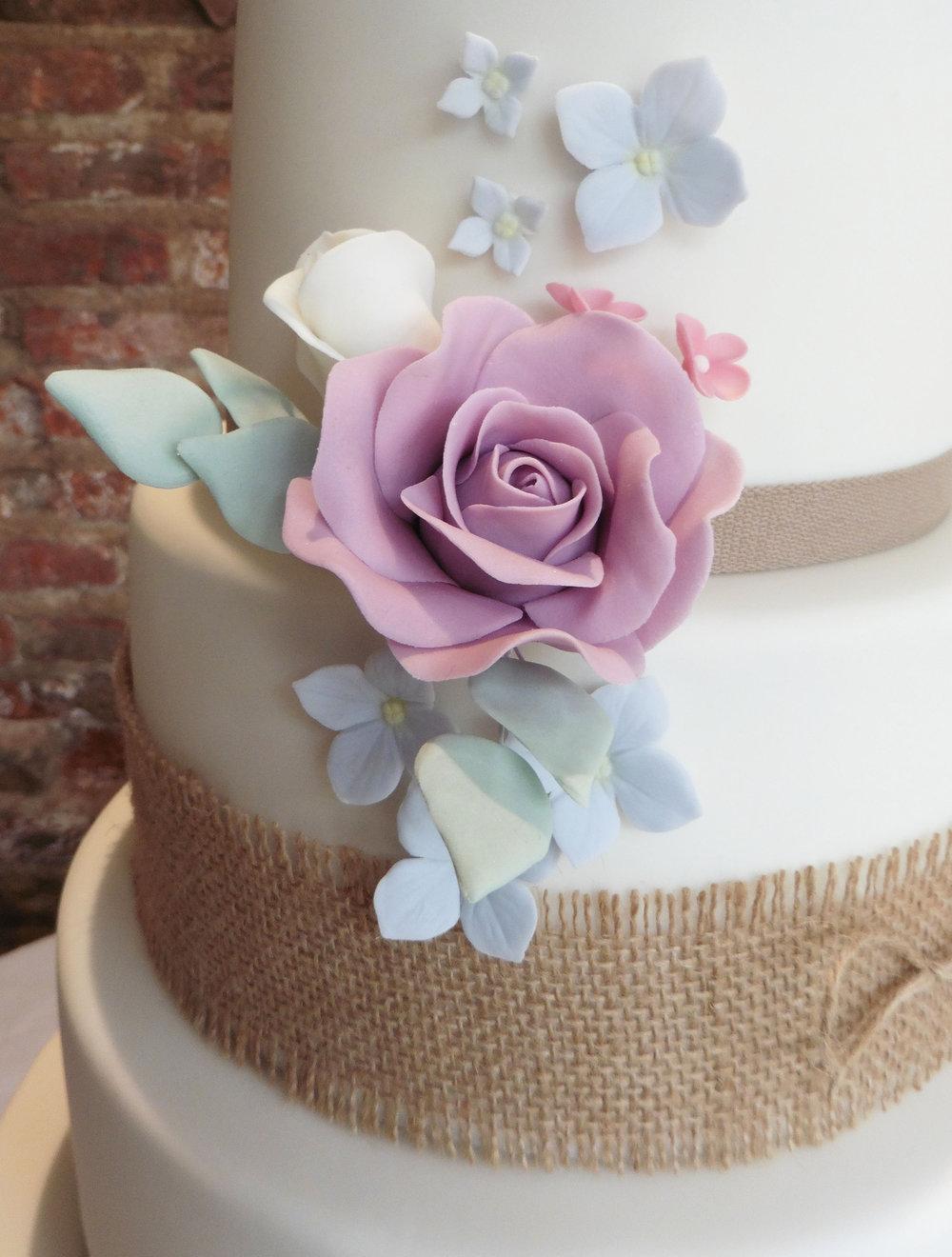 Sugar rose and hydrangea wedding cake