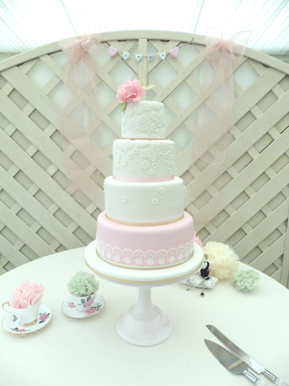 Gilded rose lace and diamante wedding cake