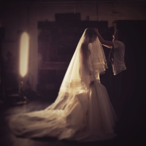 Carol Hannah makes adjustments to the  La Reine skirt  and 2 tiered horsehair veil