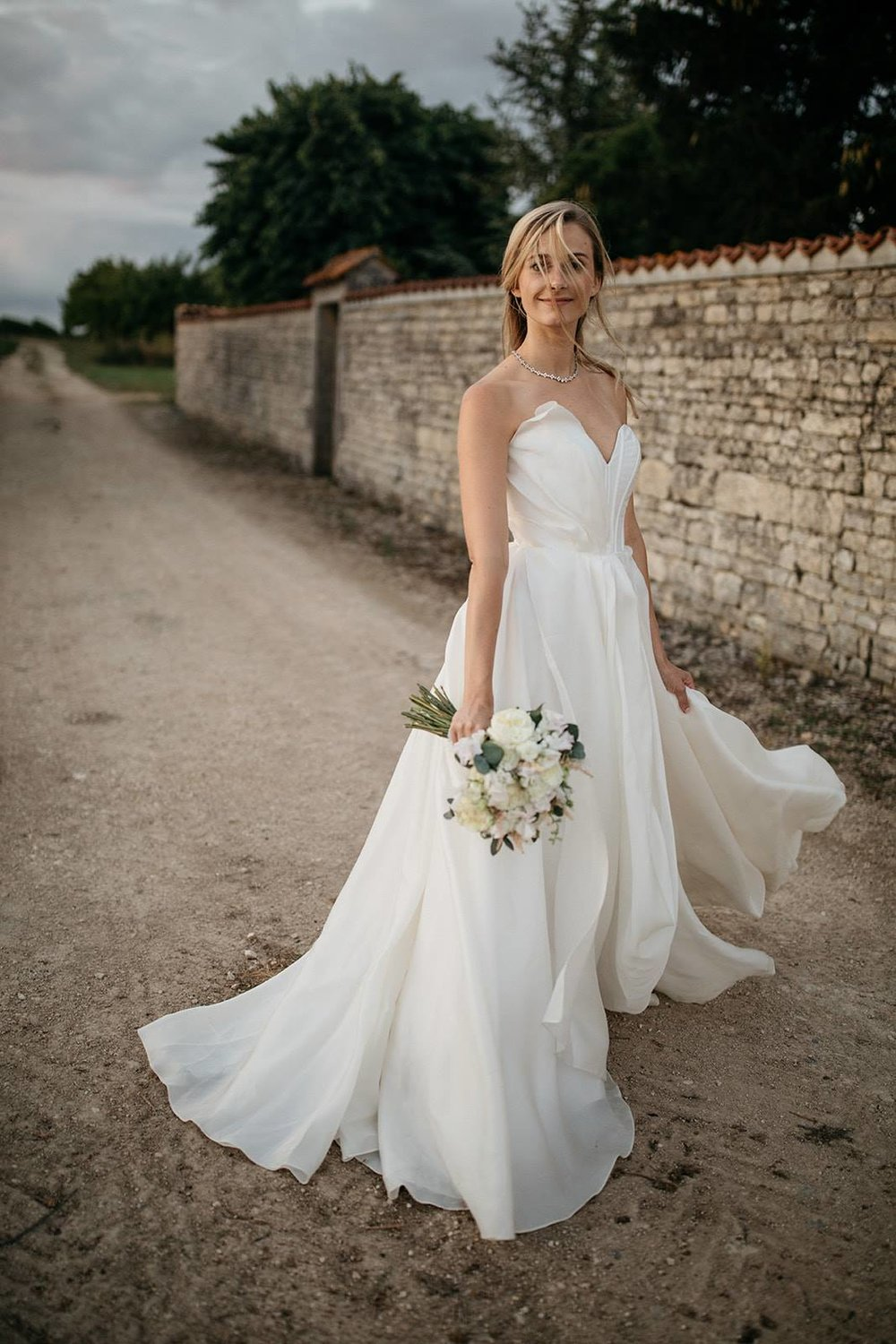 Draped ballgown architectural wedding dress2019-01-22 at 6.37.42 PM 3.jpg