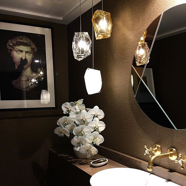 Tiny jewel of a Powder Room at our Lizzy Bay project. Walls upholstered in @phillipjeffriesltd vinyl grass cloth. Architecture by @alexander_andco
