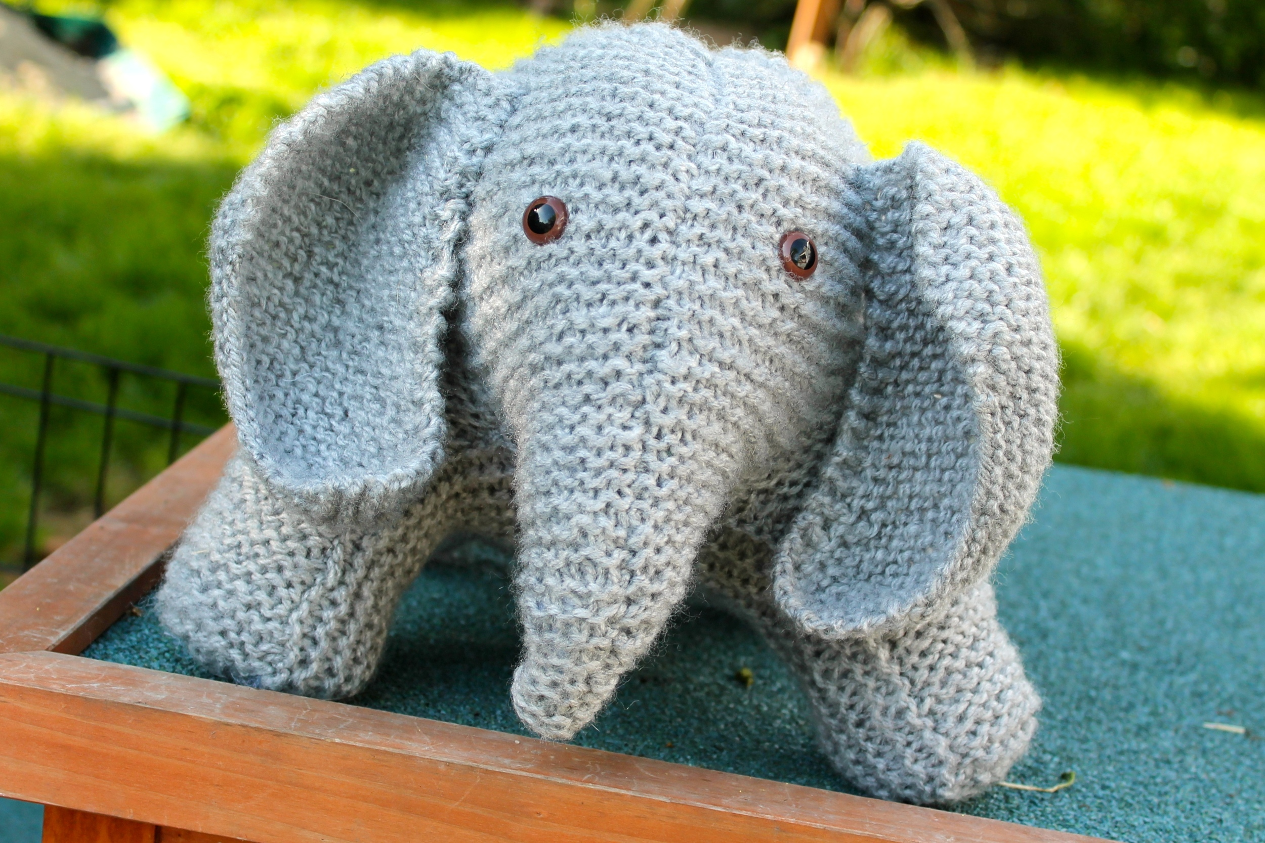 Gray knit stuffed elephant with brown glass eyes