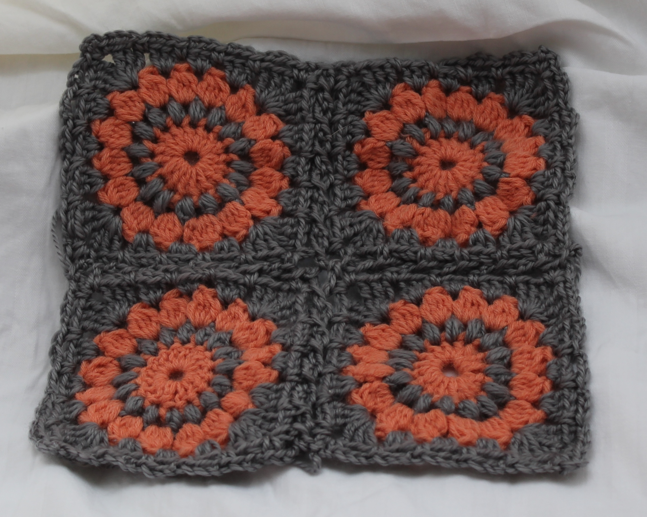 Four oral and gray granny squares