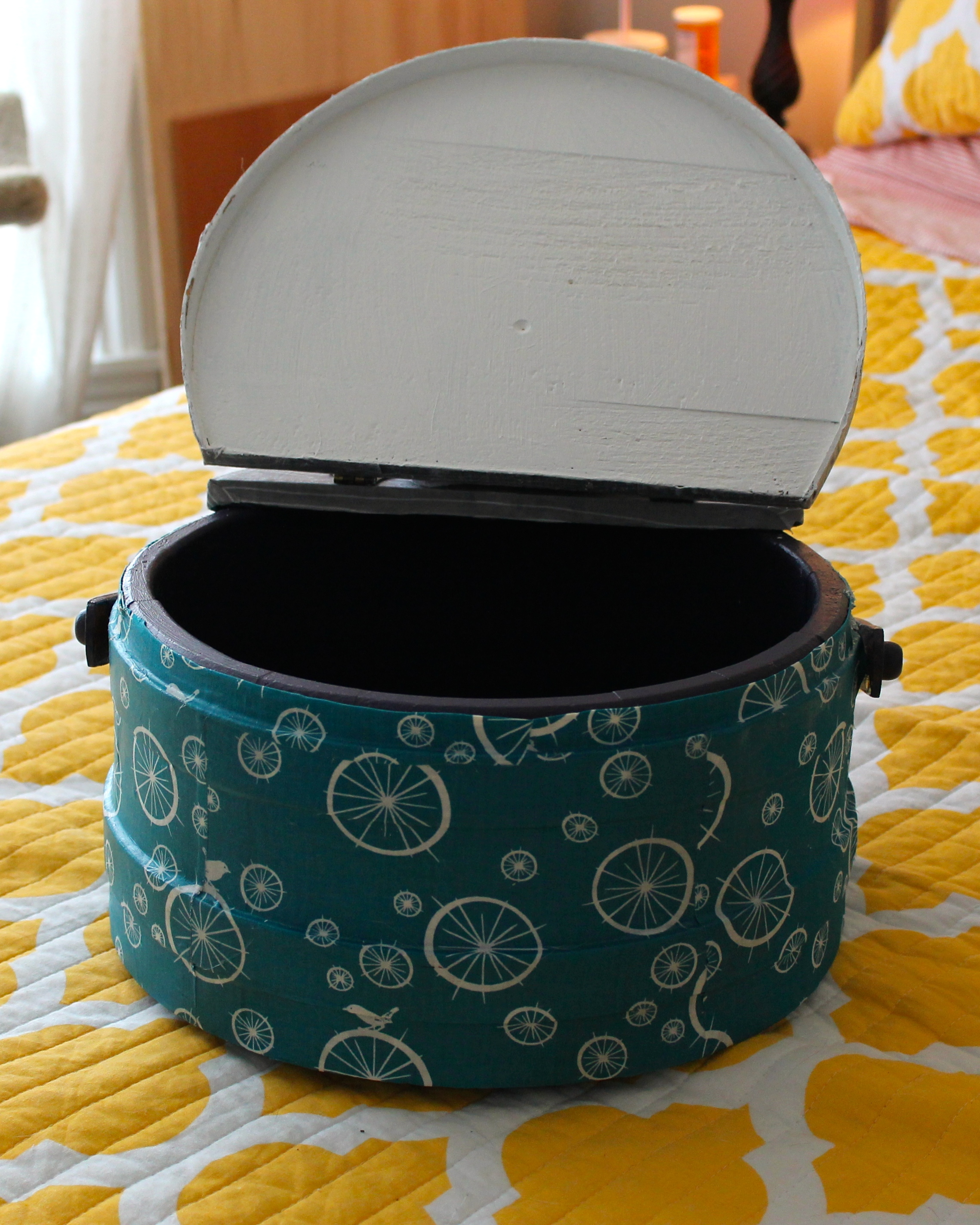 Thrift store wooden circular sewing box after update, modge podged with fabric