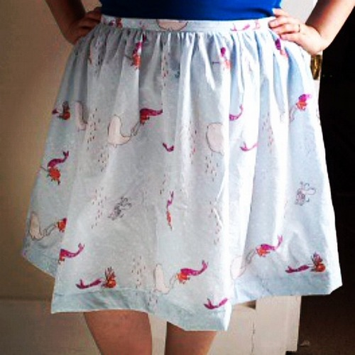 Close up of homemade skirt with mermaids, whales, and fish on it