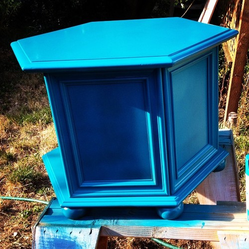 Thrift store side table being painted blue