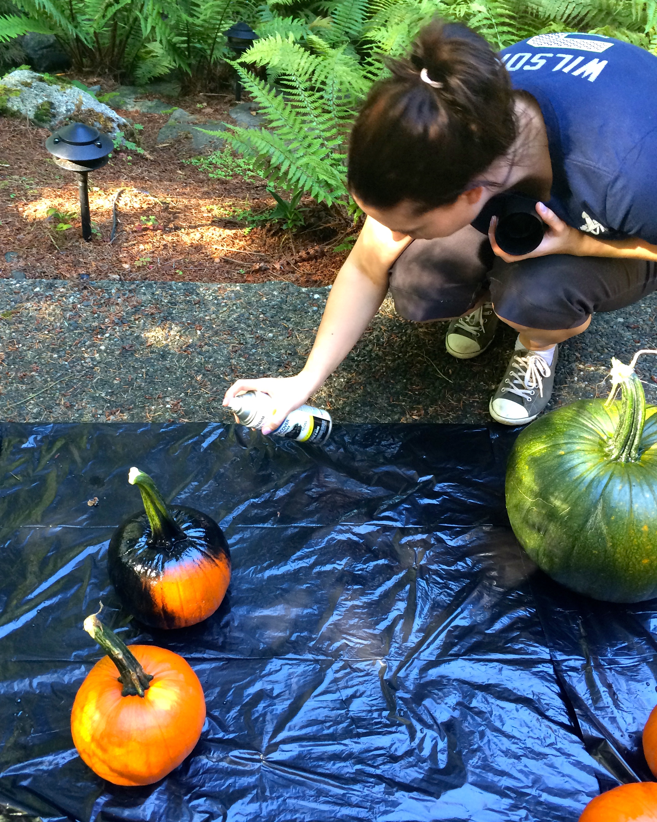 Spray painting a pumpkin