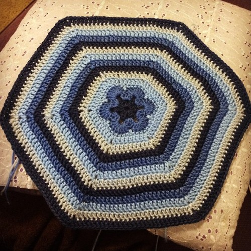Blue crocheted african flower hexagon, made with Cascade Yarns