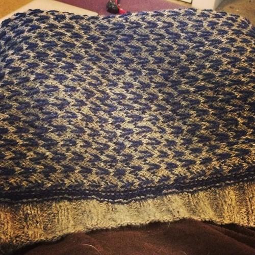 Back of navy and light brown tweed men's sweater