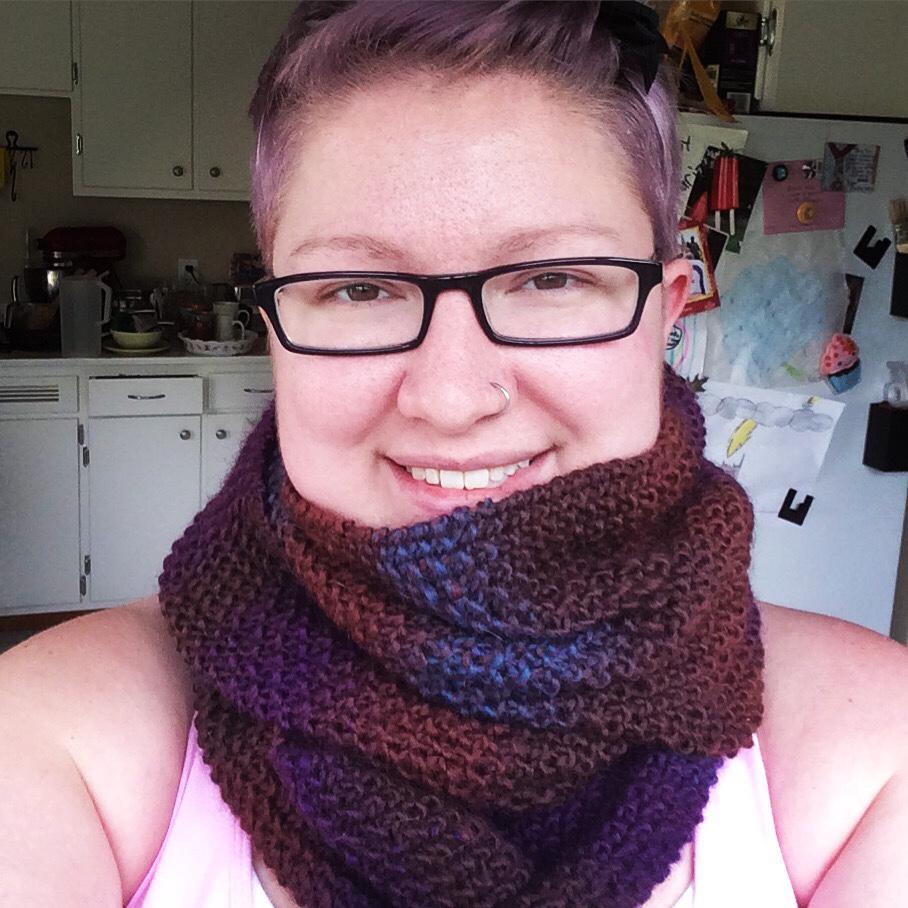 Wearing 100% wool knit scarf in variegated Nashua Handknits yarn