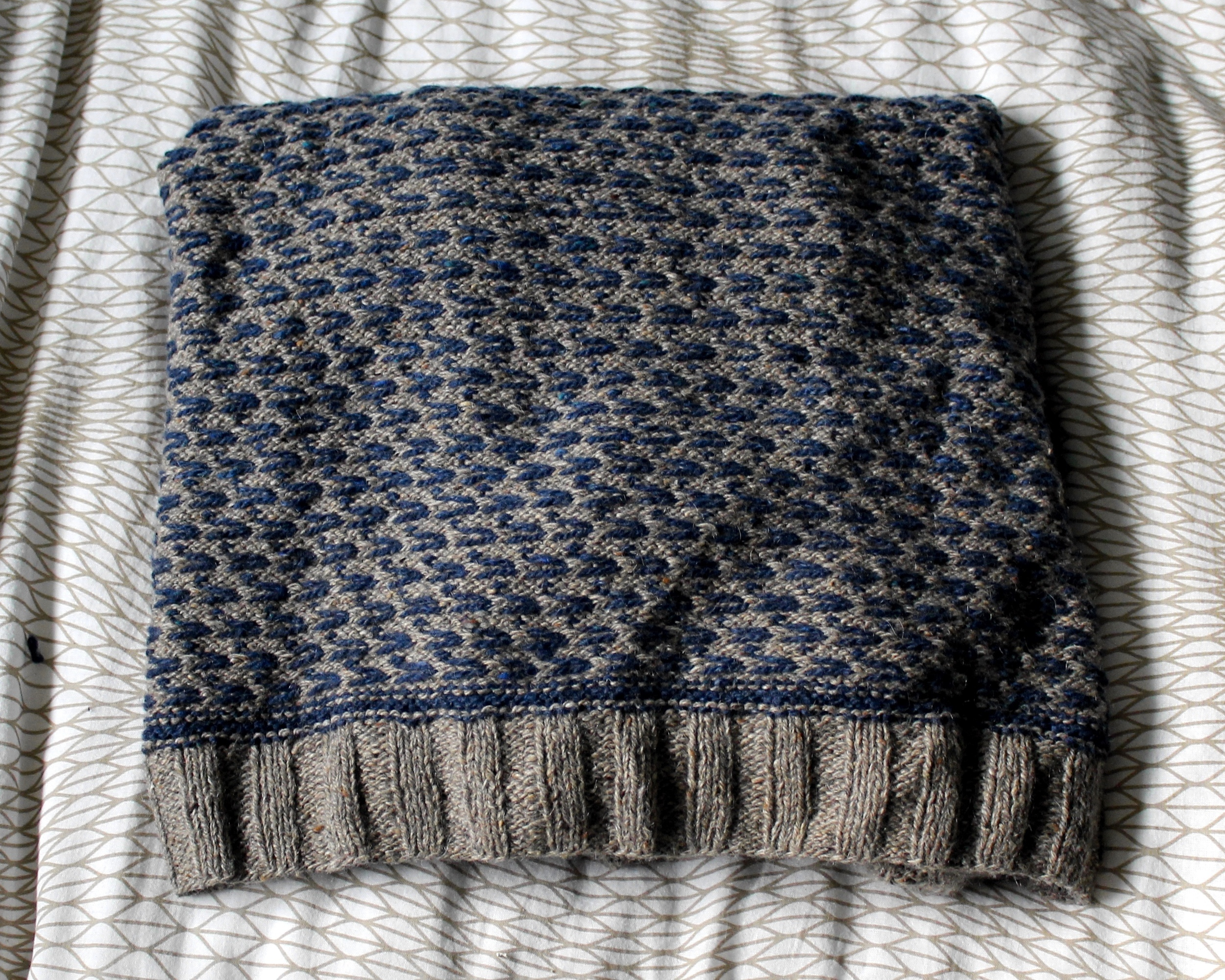 Inside of Warwick Sweater in light brown and navy tweed Berroco yarn, showing even colorwork floats