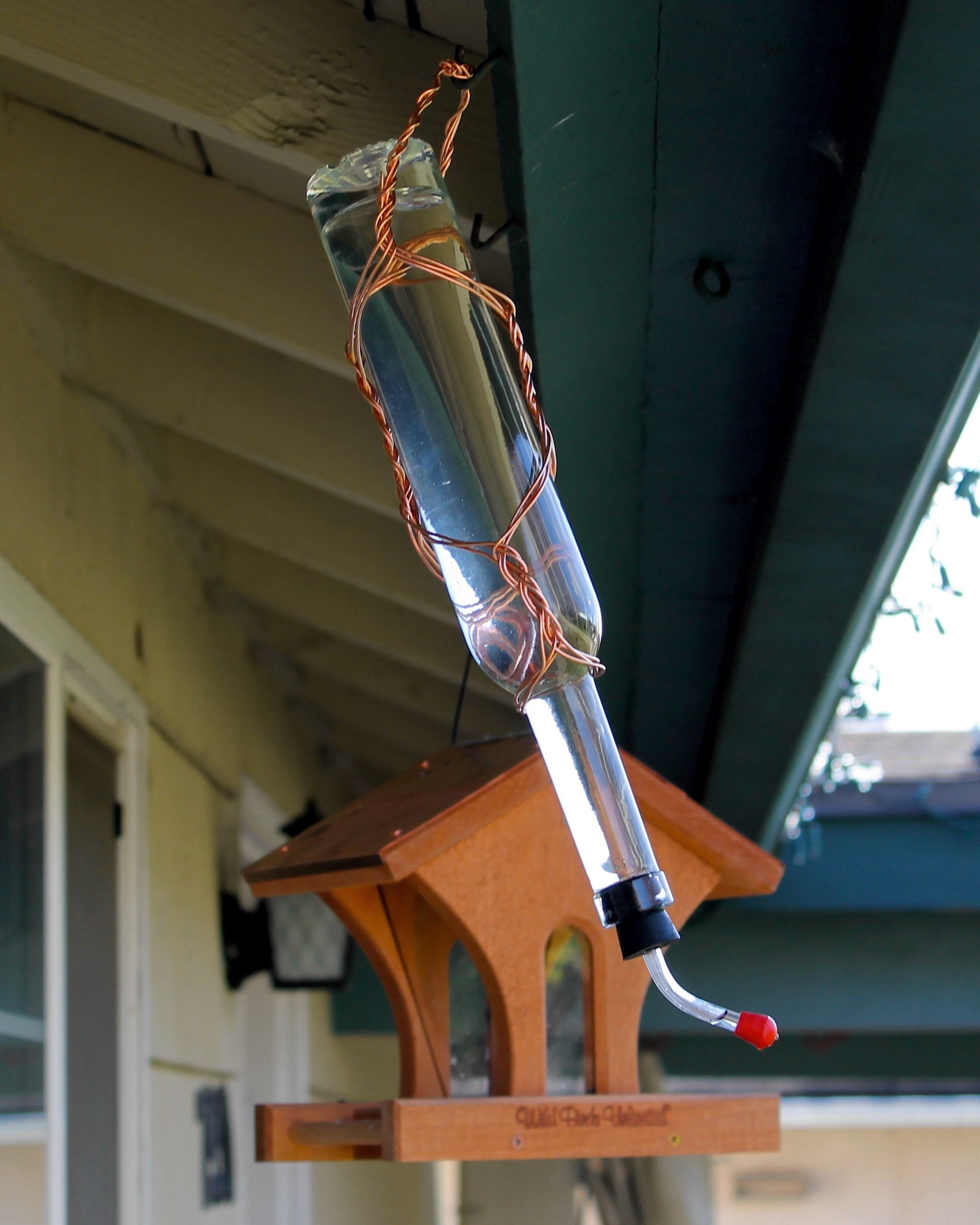 Copper wrapped bottle hummingbird feeder