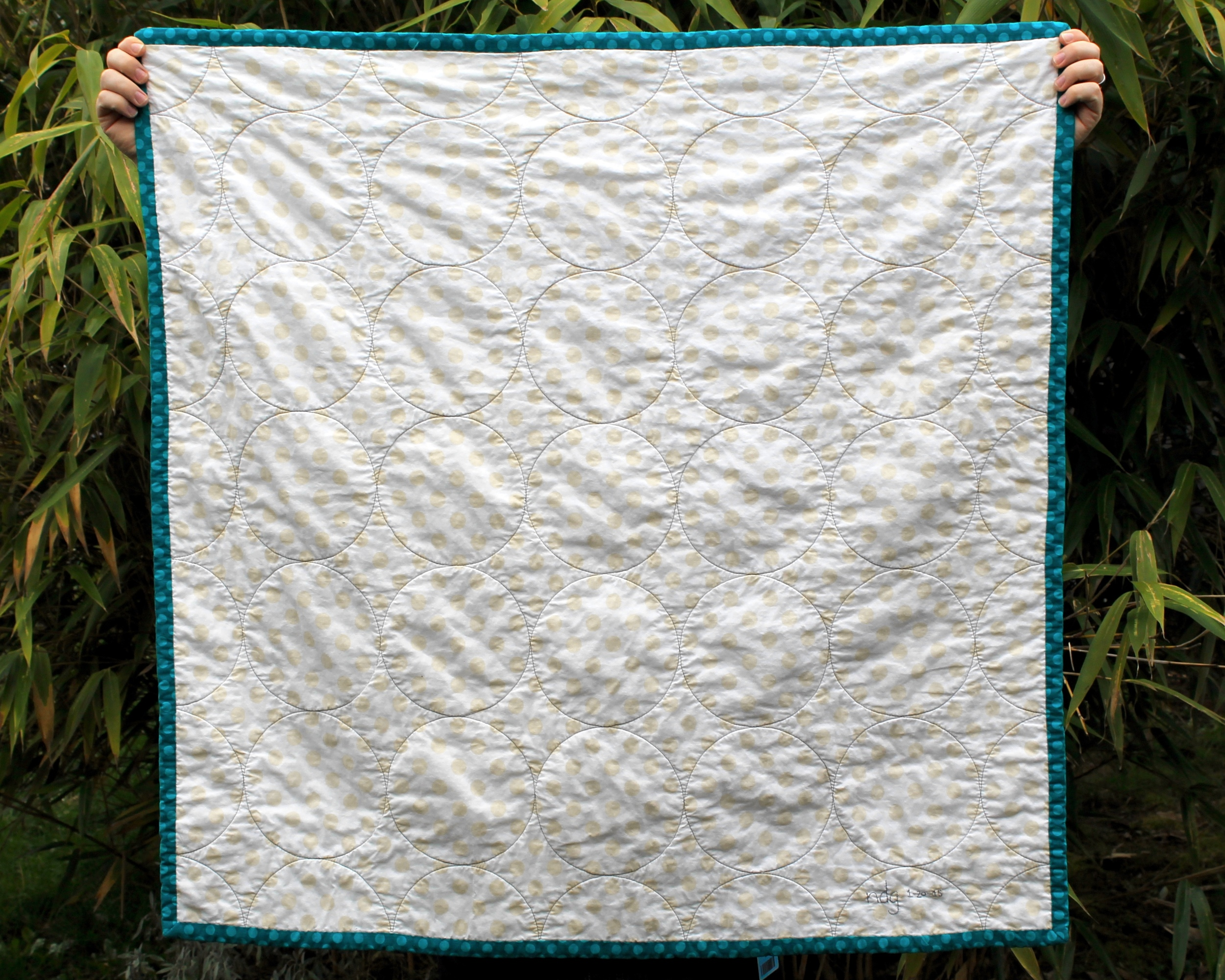 Riley Blake Medium dot Cream on Cream wholecloth quilt, teal binding