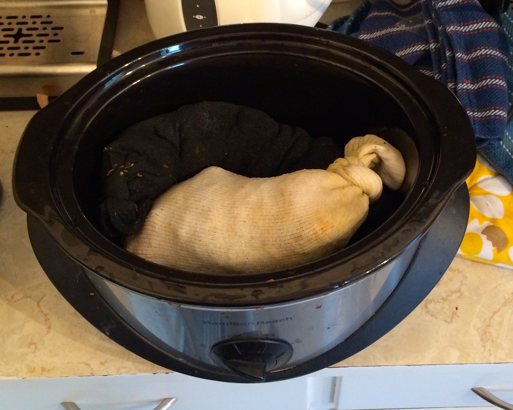 Extracting wax in socks in a crock pot