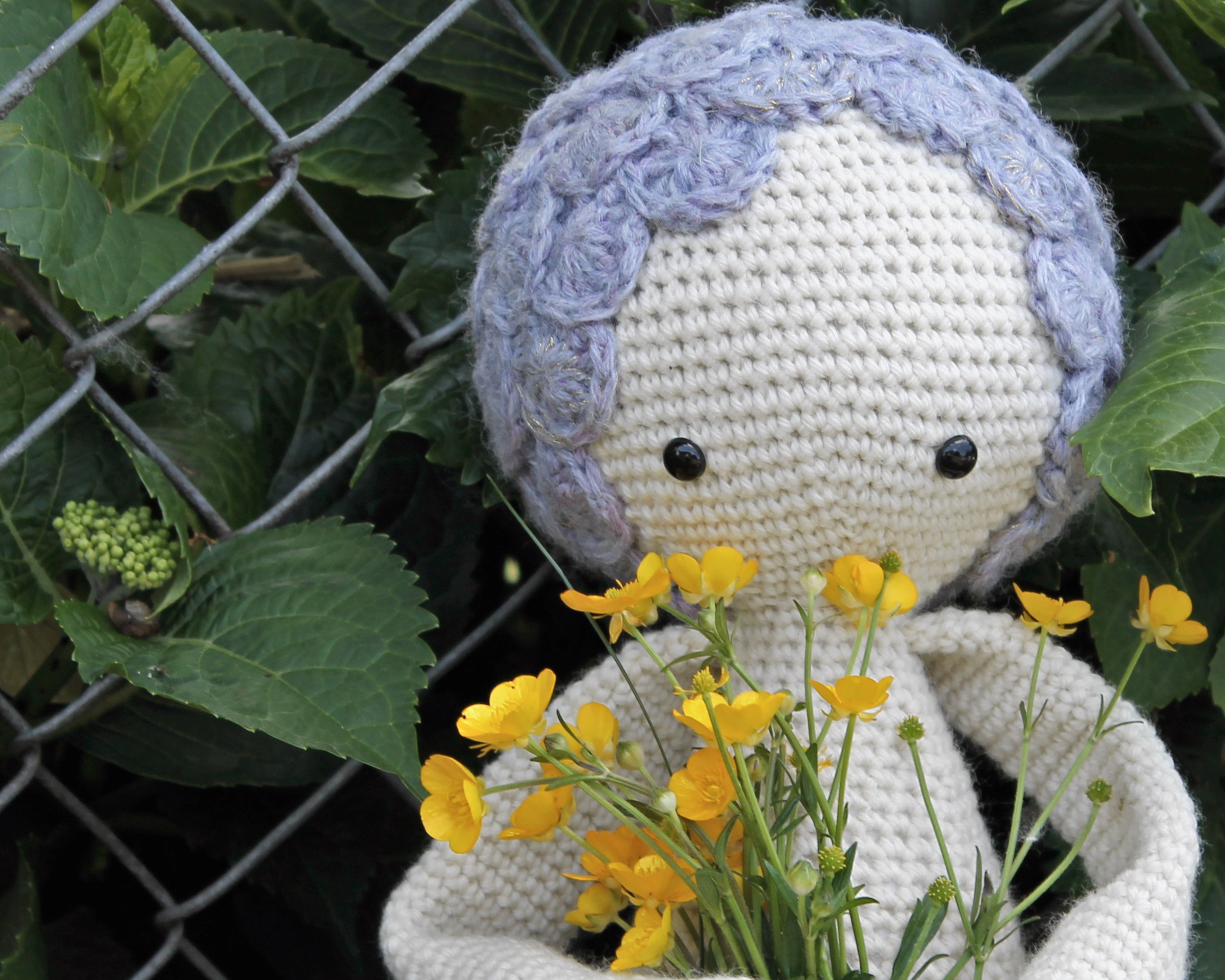 Purple Lalylala Mici the Mermaid holding buttercups