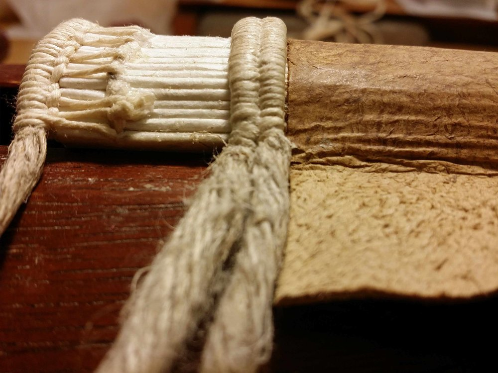 packed sewing over double hemp cords, and end band, sewn with undyed linen thread.